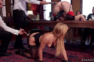 Two slaves are anal banged on table