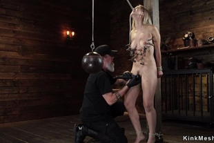 Blonde in upside down suspension toyed
