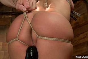 Wet redhead gets toyed on hogtie