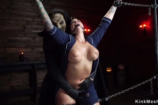 Busty slave is spanked in doggy device