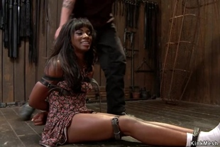 Ebony slave gets vibrated in cage