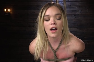 Blonde in bondage is caned