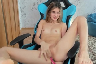 Skinny teen with small tits rubbing her shaved pussy