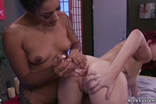 Lesbian masseuse and client anal banging