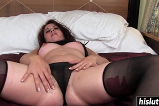 Brunette babe fingers her hairy pussy