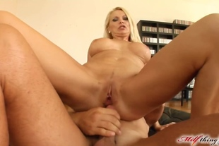 Blonde is so horny she even sucks off the cameraman