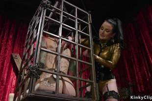 Domme whips alt male in small cage