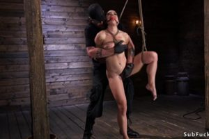 729408 Suspended Slave Gagged With Black Dildo