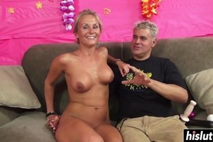Laura Crystal jerks a cock with her tits before she starts sucking it