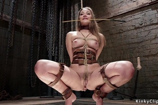 Beautiful brunette trainee is tormented